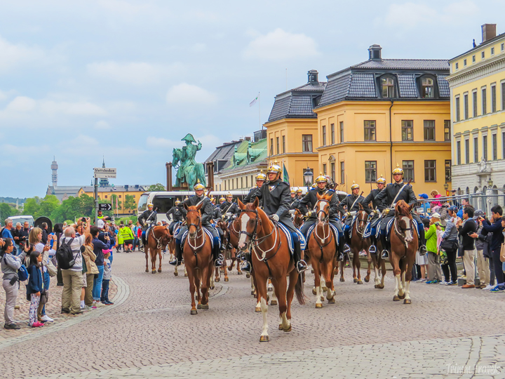 Swedish armed forces parading in on horses for changing of the guards Stockholm Sweden