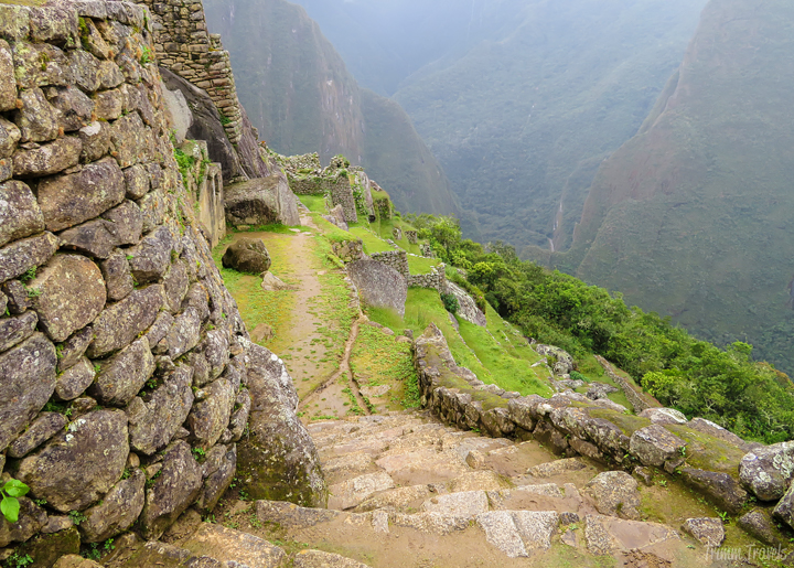 looking down stone steps in machu picchu peru