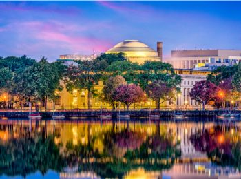 Night view of MIT buildings in Cambridge, Massachusetts with water view at twilight